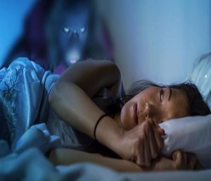 why does sleep paralysis happen